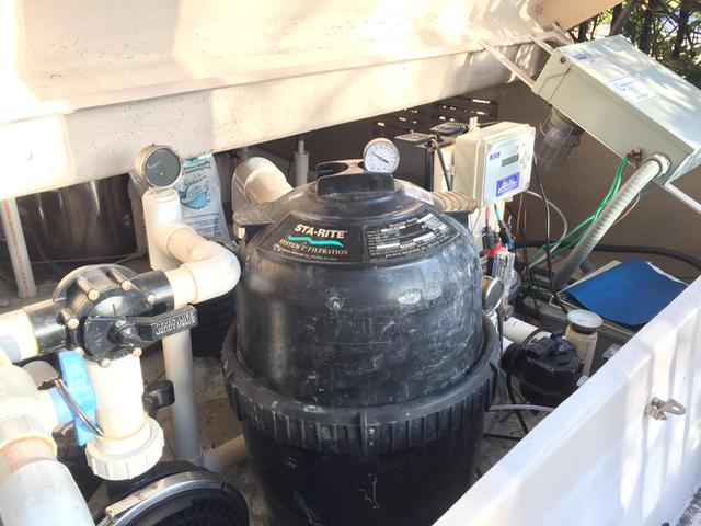 Customer pool equipment housed in fiberglass enclosure